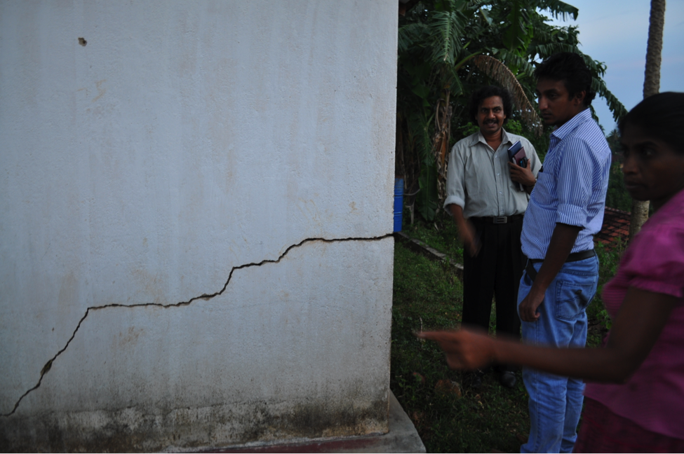 Sri Lankan female resident showing us the crack in the resettlement home provided by a nongovernmental organization two years after the Indian Ocean Tsunami (Photo credit: Michelle Meyer).