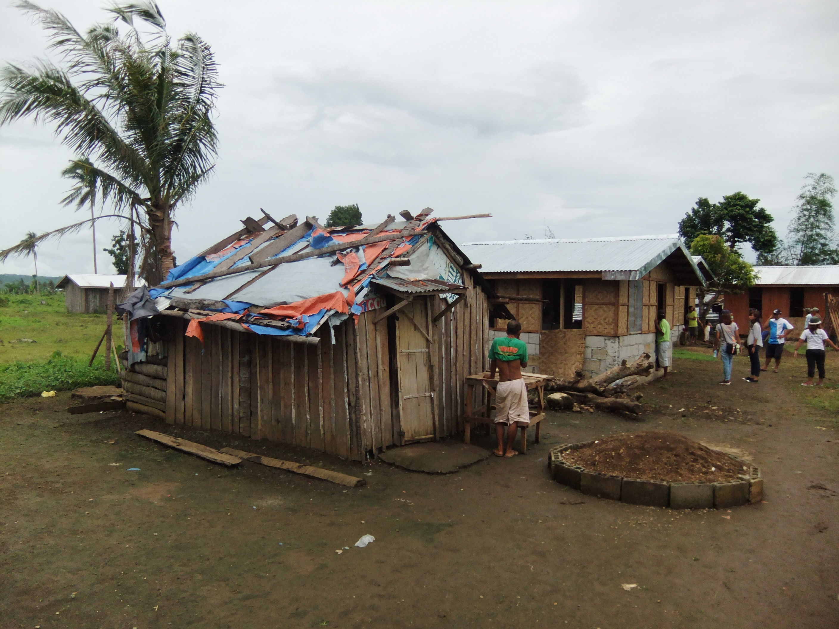 New self-built house nears completion alongside makeshift shelter, in Leyte, Philippines